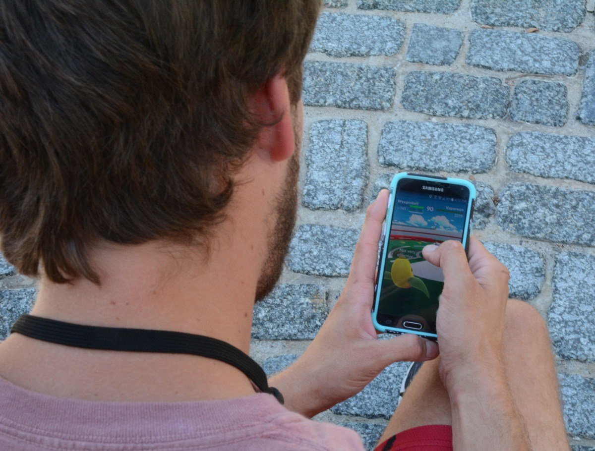 Christopher Langstand, Stony Brook student, playing Pokemon Go on campus. Photo by Emily Glennon
