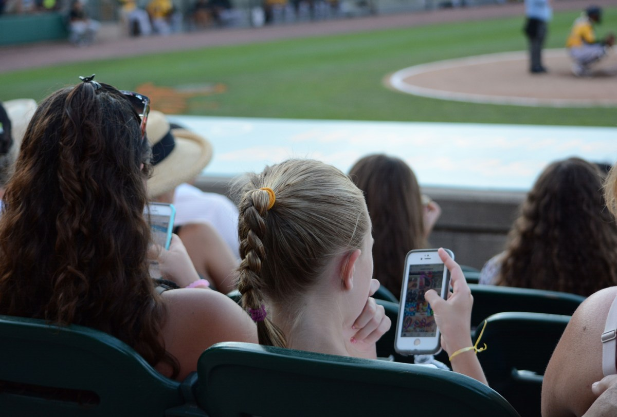 Rae Pizzirusso and her younger sister watch the Long Island Ducks play against the New Britain Bees at Bethpage Ballpark on Wednesday, July 27, 2016. Photo by Sascha Rosin.