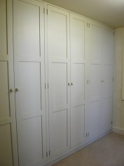 Wall of cupboard storage