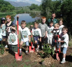 Ken with kids planting-Plute