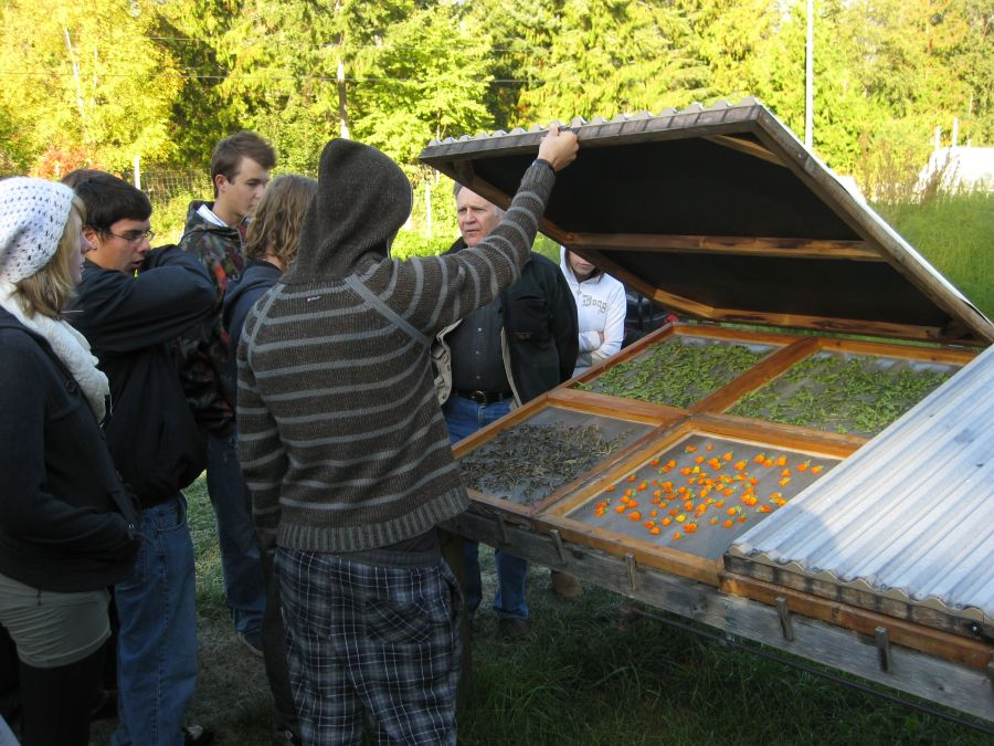 Educator talking with high school students about plant uses and prepations_Nelson BC_Nadine Lefort