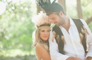 bride and groom wearing feathers