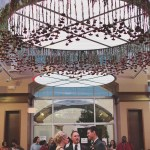 Flowers hanging from ceremony ceiling