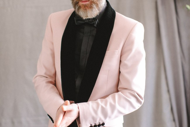 pink suited groom