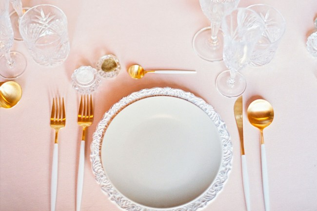 delicate white plate setting
