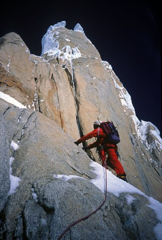 Charlie Fowler climbing toward the 90 meter traverse