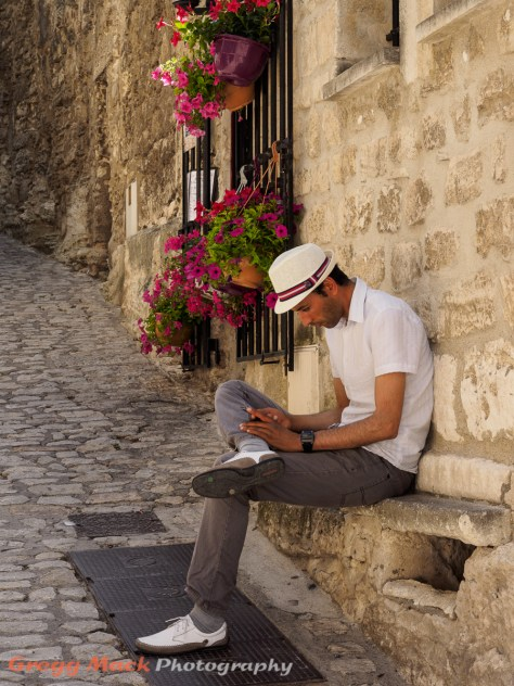 Modern smartphone user in the Medieval town of Les Baux-de-Provence