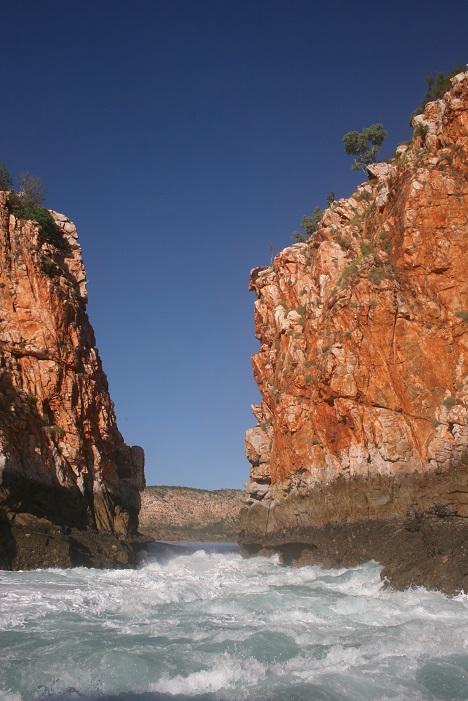 Water churns through the gap in the cliffs at Horizontal Falls