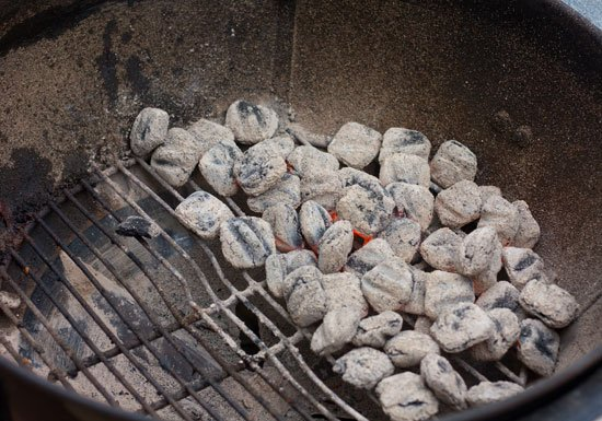 Charcoal arrangement  for grilling chicken breast.