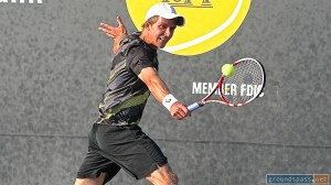 Daniel Kosakowski returns a backhand shot during the final at the 2013 La Habra Open Tennis Championships.
