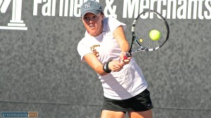 Kaitlyn Christian powers her backhand during the final at the 2013 La Habra Open Tennis Championships.