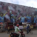 """Let's unite to celebrate Sri Lanka Cricket"" reads the hoarding in Tamil"