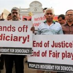 Opposition activists hold up placards during a protest in Colombo