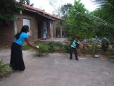 Playing cricket in courtyard