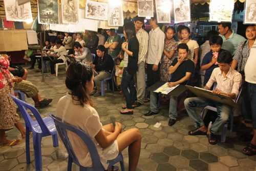 Khmer artists at night market phnom