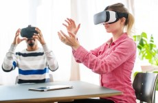 Business colleagues wearing VR glasses in office