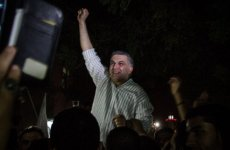 Human rights defender Nabeel Rajab, is lifted up by the