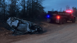 Car rolls over, sparks grass fire; driver leaves the scene