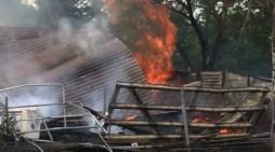 Fire destroys garage, shed; damages home
