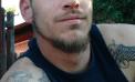 Man killed in Logan County identified; three in custody