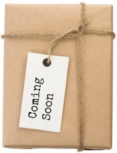 "paper wrapped book with ""coming soon"" tag"