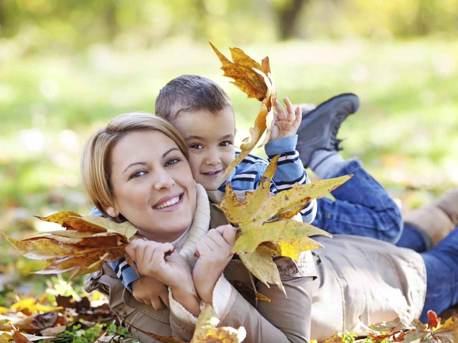 Legend Of The Fall Tour Wallpaper Mother And Son Enjoying Autumn In Park H A Fisher
