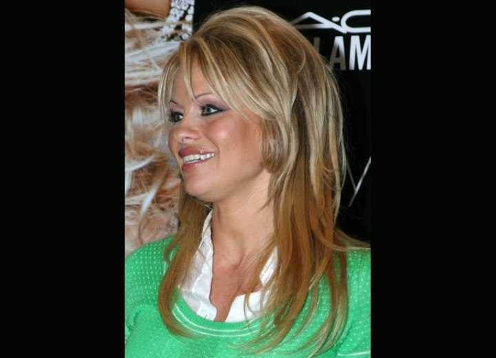 Black Hairstyles With Short Hair Pamela Anderson With Dark Streaks In Her Blonde Hair