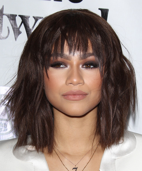 long hairstyle razor cut and with wide straight bangs