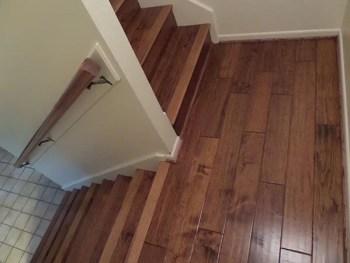 Abbot Flooring installed Heirloom Buckskin engineered hardwood flooring on a staircase for a homeowner.
