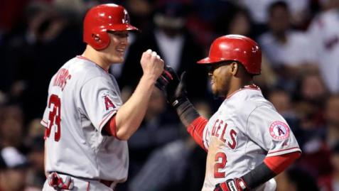 Los Angeles Angels' Erick Aybar is congratulated by teammate Marc Krauss after his two-run home run in the fifth inning of a baseball game against the Boston Red Sox at Fenway Park in Boston, Friday, May 22, 2015.  The Angels scored nine runs in the fifth inning. (AP Photo/Charles Krupa)