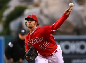 C.J. Wilson throws a pitch during the first inning of a game against the Seattle Mariners at Angel Stadium on May 6, 2015 (Victor Decolongon/Getty Images)