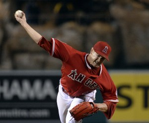 Garrett Richards delivers the last pitch of the game during the ninth inning of a game against the Boston Red Sox at Angel Stadium on July 18, 2015. Richards tossed a complete game shutout that night. (Kevork Djansezian/Getty Images)