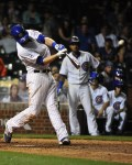Kris Bryant drives a home run during the 8th inning of a game against the Los Angeles Dodgers at Wrigley Field on June 22, 2015 (David Banks/Getty Images)