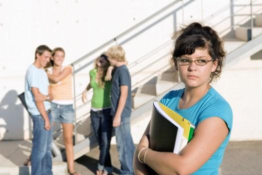 bigstock-outcast-sad-girl-at-university-16236611