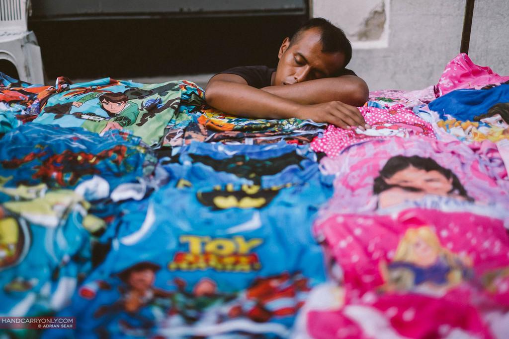 seller asleep in san telmo market, buenos aires, Argentina