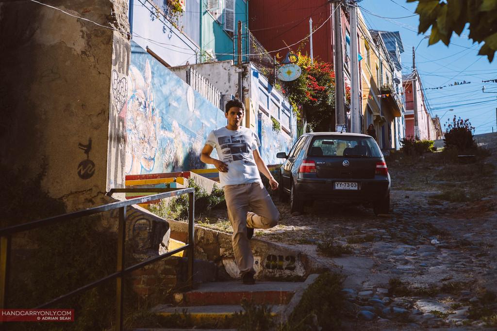guy walking down hill valparaiso chile