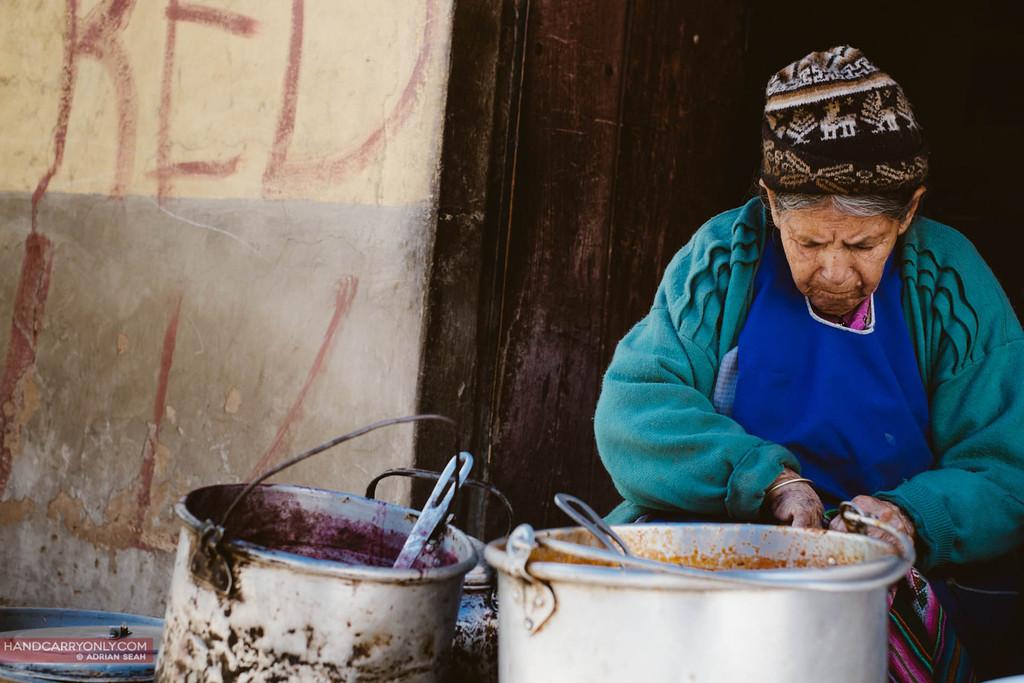 old lady selling wares, tarabuco sunday market, bolivia