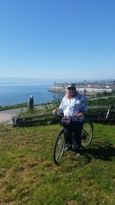 Linda along the shore of St James Bay on our bike ride