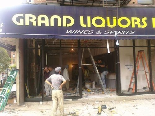 Grand Liquors Inc. in Harlem out, bank or check cashing place in
