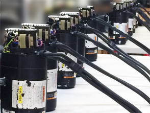 hoist motors lined up in the service shop