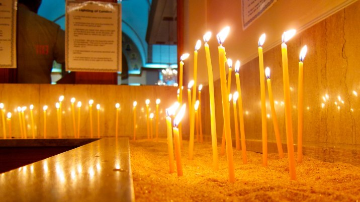 Orthodox worshipers light candles as offerings to accompany their prayers