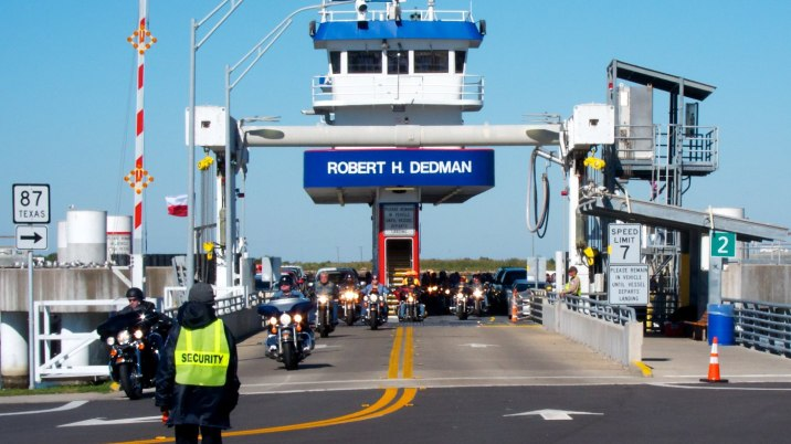 Waiting to board the ferry; dozens of rally-bound bikes exit first.