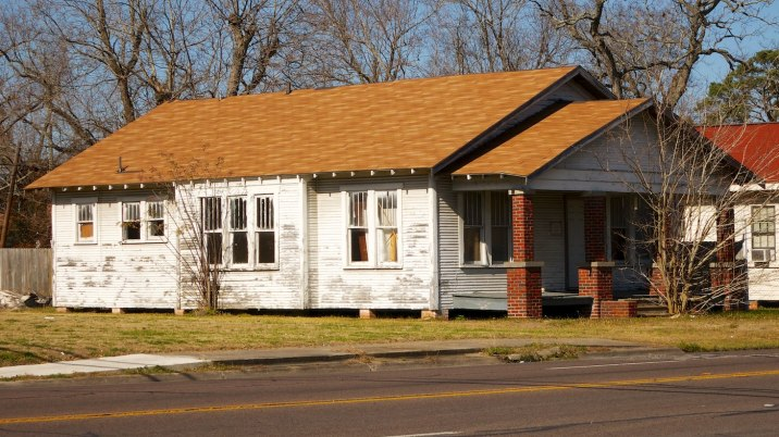 The homes of Port Arthur look weatherworn and tired.