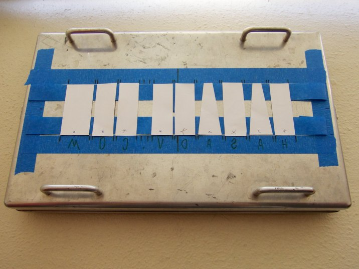 Place the cut letters into position onto strips of upside-down gaffer's tape.