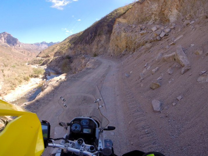 With a steep fall to my left, I keep to the inside even if it is deeper sand than the left.
