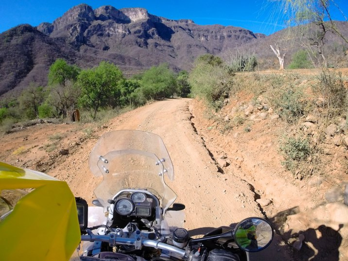 I'm careful not to expect the bodacious dirt riding skills I killed at yesterday to have survived the night. Fortunately, the road on this side of the range is dry and solid.
