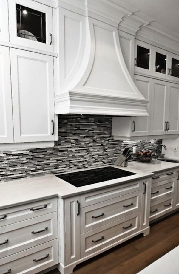 black grey linear glass tile backsplash crisp white cabinetry clear white laminated kitchen backsplash ideas design