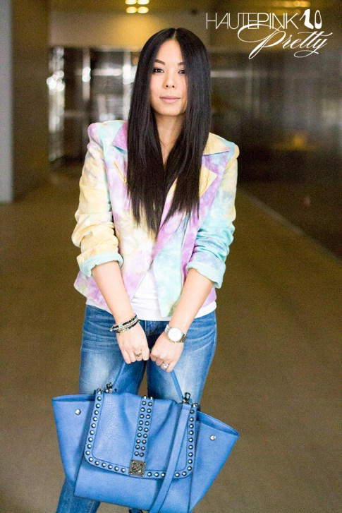 An Dyer wearing This Is A Love Song's No Doubt Tie Dye Moto Jacket, Ditto Jeans, Melie Bianco Villette, Haute Betts Sanctuary Bracelets, Michael Kors Mother of Pearl Chronograph Watch