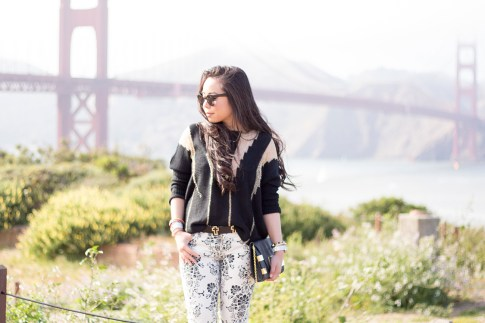 An Dyer wearing Fidelity Denim White Floral Jeans, ASOS Cross Belt, Rehab Black Sheer Mesh Sweater, Metal Frame Cat Eye Sunglasses, Golden Gate Bridge, Fort Point, San Francisco