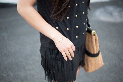 An Dyer wearing Gorjana Griffin Chevron Bracelet and Lena Shimmer Double Bar Ring, Lovers & Friends Kiss Me Top, Zara Leather Fringe Skirt